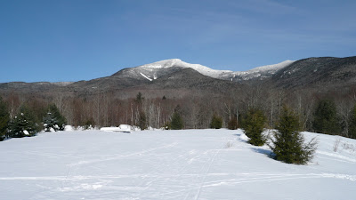 Mt Osceola from the yurt, snow to top of picnic tables