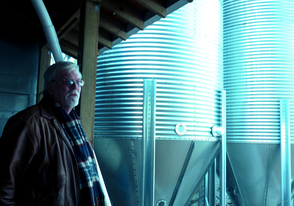 Bob McClellan with outdoor fermentors.  Photo by Jean Geoghegan.
