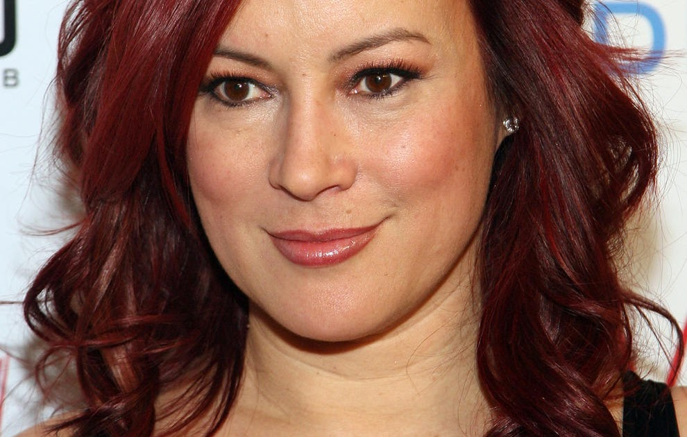 Jennifer Tilly is Exposing some Mature Cleavage and Still