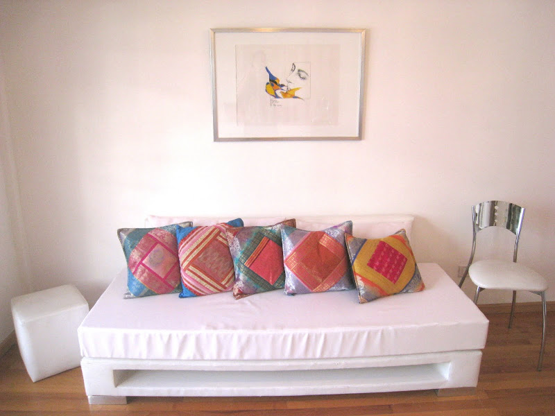 Modern style furnitures with colorful details .and original paintings  title=