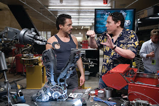 Downey and Favreau on the set