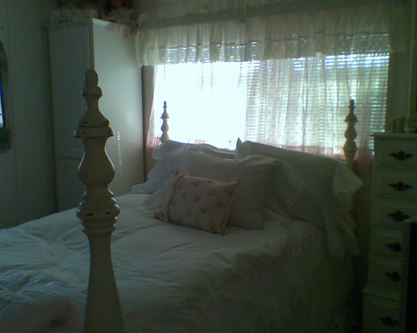 Her big bed in her little bedroom