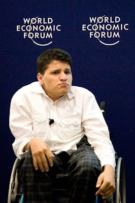 Musa, a young man in a wheelchair, pulling a face during his rap