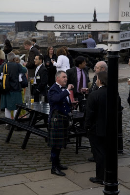 Outdoor reception with man in kilt and sign saying Castle Cafe