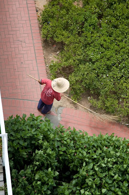 View of person sweeping from above