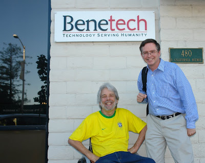 Scott Rains wearing Brazill football jersey and Jim Fruchterman, under the Benetech office sign