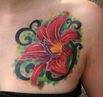 Some people just love lily flower tattoos design and its smell though some