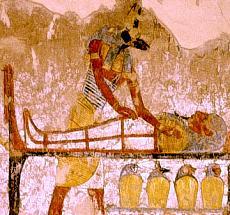 Anubis prepares a mummy