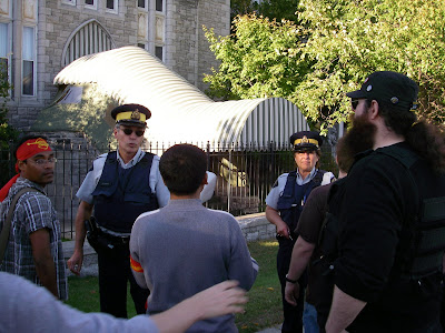 RCMP officers meet the protesters