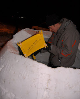 Chris packing snow in the block mold.