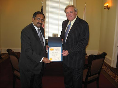 Rajasekar receiving the certificate from Lt. Governor of Alabama State