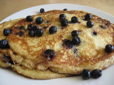 Serve pancakes warm with additional berries and maple syrup.