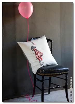 girl with a pink balloon cushion