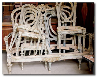 stacked vintage chairs