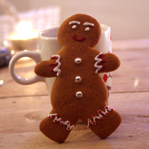 Gingerbread man cookie and a cup of coffee