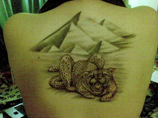 cheetah tattoo on back body