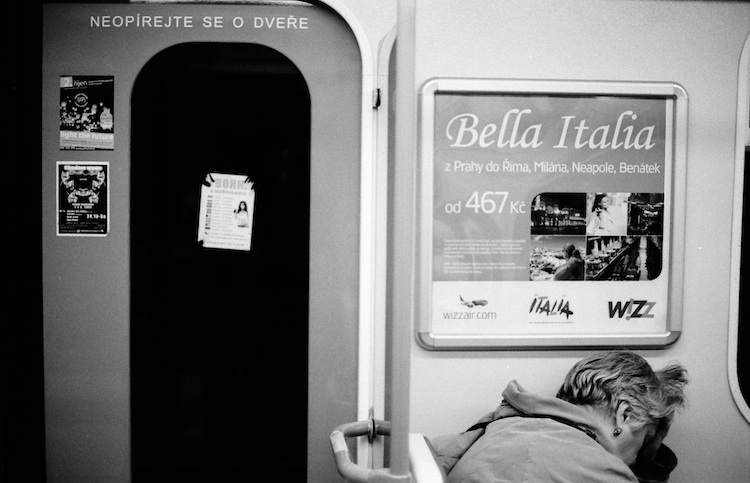 Bella Italia poster in Prague metro