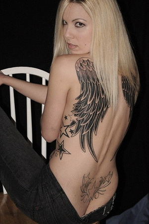 Angel wings tattoo in all