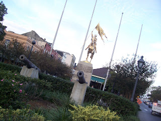 a gilded statue in New Orleans along the riverfront near French Market