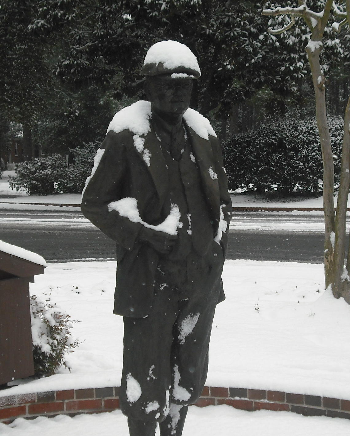 Statue of Donald Ross under snow