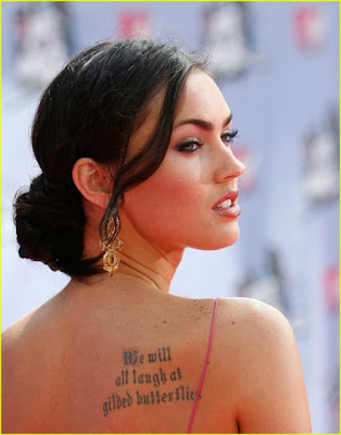 megan fox rib tattoo. blossom rib quote tattoos