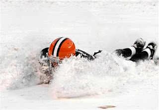 Derek Anderson slides in the snowy end zone to celebrate the Browns victory over the Bills