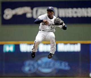 Weeks leaps sliding baserunners in a single bound
