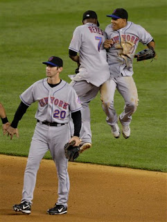 Reyes and Gomez are excited after beating the Yankees in Yankee Stadium on June 15