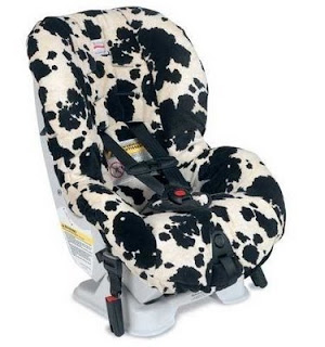 Chase's Britax Cowmooflage car seat, probably jacked up by 20%