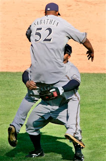 CC Sabathia celebrates his 1-hitter by jumping into the arms of Prince Fielder, the only guy big enough to catch him