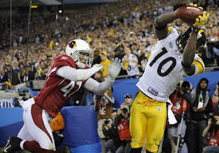 Santonio Holmes lands with two feet down -- in history