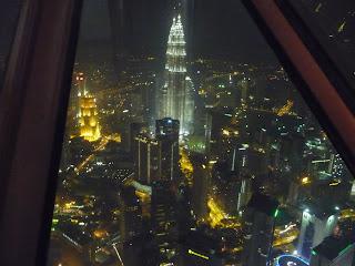 Petronas Twin Towers at night - view from KL Menara Tower, Kuala Lumpur, Malaysia