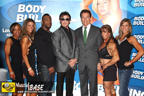 They Are All Standing At BODYBUILDINGCOM Booth Arnold Schwarzenegger Specially Invite To Sylvester Stallone For 2010 Amateur Bodybuilding Contest