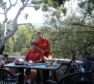 In the shade of a few trees, pausing for a coffee break on the Chateau Hill, Dave and his partner Jimin from Nice Cycle Tours.