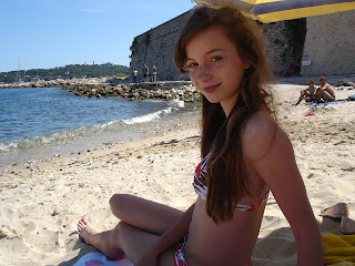 my daughter enjoying the sandy beach in Antibes