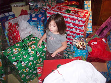 Layla caught in the middle of all the gifts!