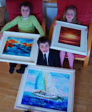 Pupils Conor, Dara and Maisie show some of the artists' work to the Press