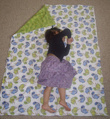 Naya (3 years) on the blanket to show its size.