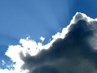 Bright light shining behind a dark cloud