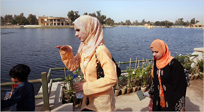 Women walk through Baghdad's Zawra Park. Joao Silva for The New York Times