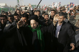 Abdul-Aziz al-Hakim, leader of Shi'ite religious political party Islamic Supreme Council of Iraq (ISCI), waves to supporters during an election campaign rally in Najaf, south of Baghdad January 25, 2009. There are 14,431 candidates registered to contest just 440 council seats across Iraq for the coming January 31 provincial election. (c)2008 Reuters.