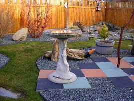 WE HAVE A LARGE SELECTION OF BIRDBATHS....