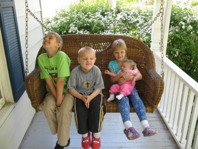 kids on porch swing