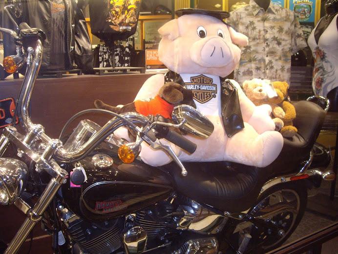 PINK SANTA CLAUS PIG RIDING A MOTORCYCLE