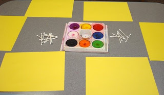 Tempera Cakes in Tray, Q-tips, and Yellow Paper