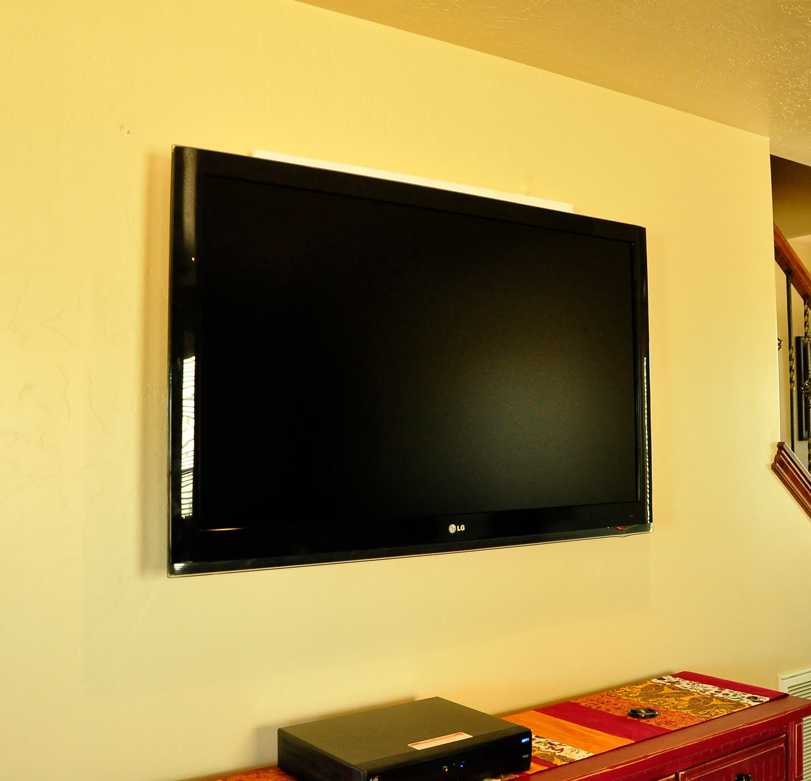 Cover up ugly LCD TV brackets | All Things Thrifty