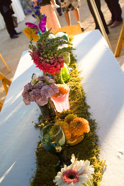 Wedding Runners with Moss and Flowers and Mismatched Vases