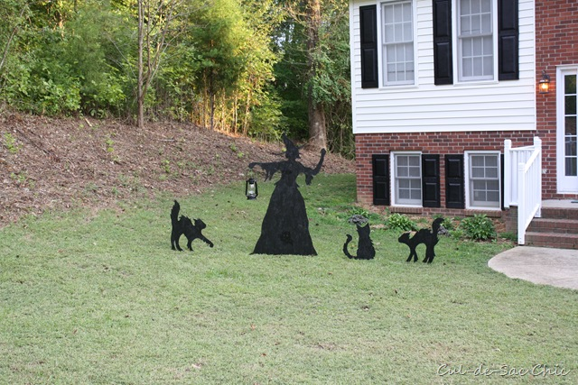 with a little paint and hardware to stake them into her lawn she created an absolutely adorable and cheap halloween decoration - Cheap Halloween Decor