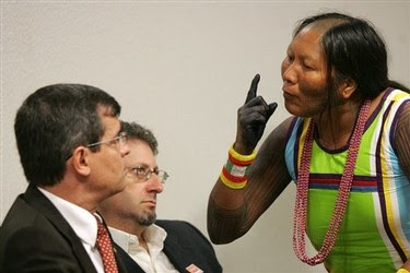 Tuira Kayapo, right, leader of the indigenous tribe Kayapo, speaks to Aloysio Guapindaia, left, director of the National Indian Foundation during a public hearing at the Commission of Human Rights of the Federal Senate, in Brasilia, Wednesday, Dec. 2, 2009.