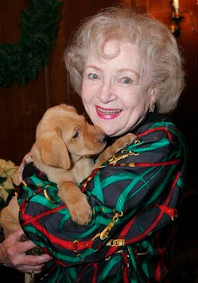 Betty White with a GDB puppy